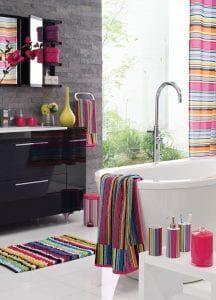 Bright towels and accessories can help breathe life into a dated bathroom.